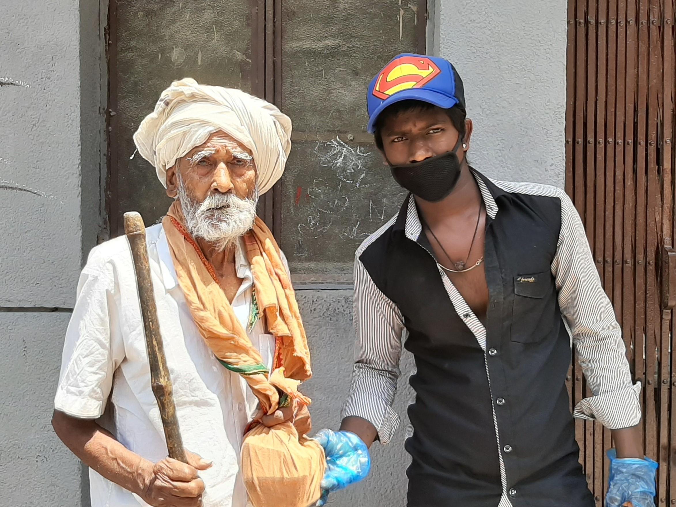 old-sadhu-getting-food